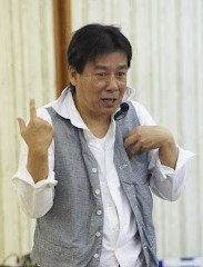谷村英司さんの顔写真